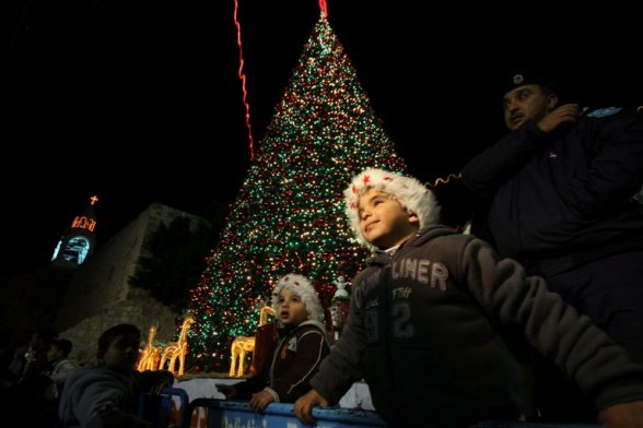 Bethlehem - Christmas tree lighting celebration in Manger Square Photo by Ahmed Mazhar - WAFA