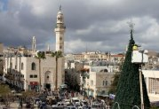 dec-14-2012-bethlehem-bethlehem-municipality-crews-continue-their-work-in-decorating-the-christmas-tree-in-manger-square-photo-by-ahmed-mazhar-1