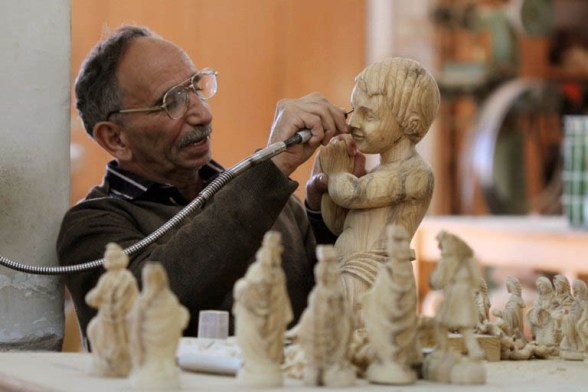 Dec 19 2012 - Carvers create religious figures in olive wood for Christmas – Bethlehem - Photo by Ahmed Mazhar / WAFA