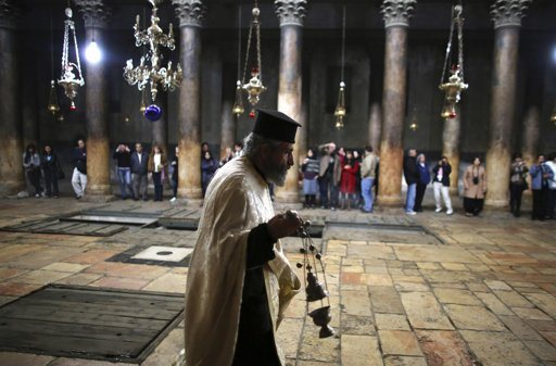 A Greek Orthodox priest walks inside the Church of the Nativity, the site revered as the birthplace of Jesus, ahead of Christmas in the West Bank town of Bethlehem December 22, 2012. REUTERS/Ammar