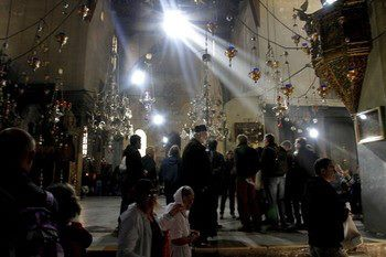 Mideast Israel Palestinians Christian worshipers visit the Church of Nativity, traditionally believed by Christians to be the birthplace of Jesus Christ, ahead of Christmas, in the West Bank town of Bethlehem, Sunday, Dec. 23, 2012. (AP Photo/Nasser Shiyoukhi) AP