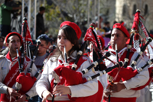Dec 24, 2012 Bethlehem - Scouts enter  Manger Square in preparation for the reception of the Patriarch to celebrate Christmas Photo by Eyad Jadallah - WAFA3