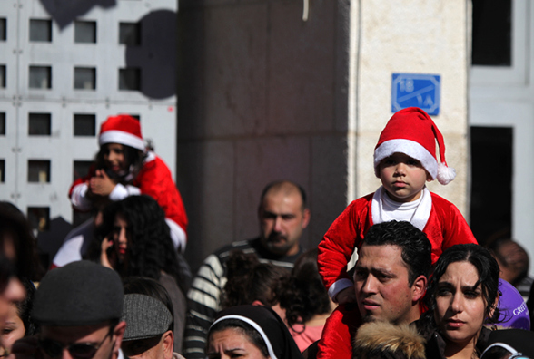 Dec 24, 2012 Bethlehem - Scouts enter  Manger Square in preparation for the reception of the Patriarch to celebrate Christmas Photo by Eyad Jadallah - WAFA