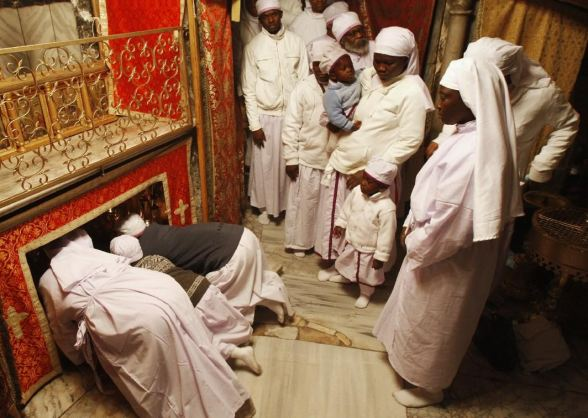 Dec 24 2012 Christian worshippers from Nigeria pray in the Grotto of the Church of Nativity