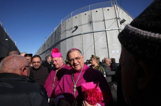 Latin Patriarch Fuad Twal passing the Israeli checkpoint. religion under siege on his way to Bethlehem, Dec 24, 2012