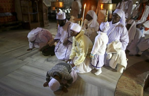 Dec 24 2012 Nigerian pilgrims sit inside the Church of Nativity in Bethlehem  2