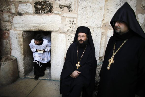 Dec 24 2012 Orthodox Christian priests wait for the arrival of the Latin Patriarch of Jerusalem Twal at the