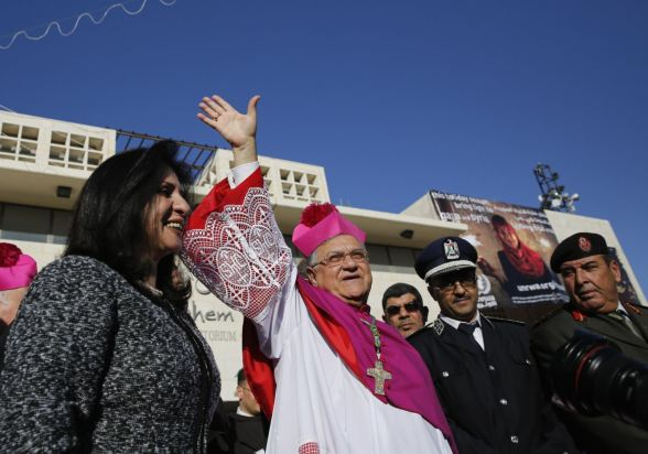 Dec 24 2012 The Latin Patriarch of Jerusalem Twal waves as he arrives for Christmas celebrations at Manger Square