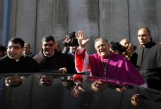dec-24-2012-the-latin-patriarch-of-jerusalem-twal-waves-upon-his-arrival-to-bethlehem-after-crossing-an-israeli-checkpoint