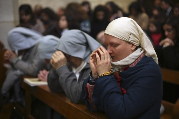 Dec 25 2012 A nun prays during Catholic mass at the Church of St. Catherine in the West Bank town of Bethlehem on Christmas day