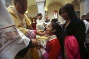 dec-25-2012-a-palestinian-girl-receives-communion-from-the-latin-patriarch-of-jerusalem-twal-at-the-church-of-st-catherine-in-bethlehem-on-christmas-day