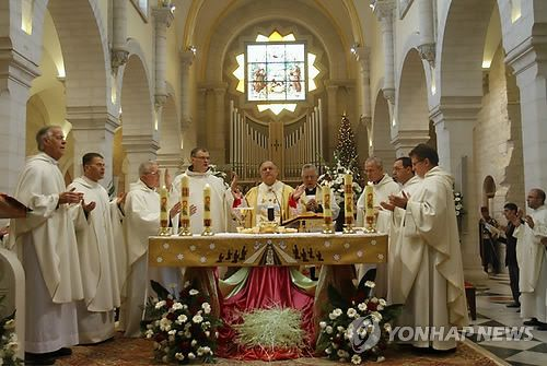 Dec 25 2012  Latin Patriarch of Jerusalem Twal at the Church of St. Catherine in Bethlehem on Christmas day