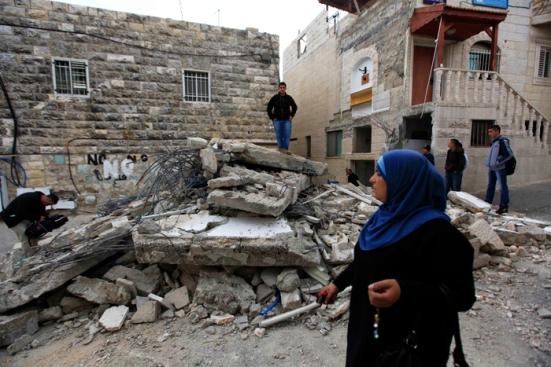 Israeli Forces demolish a house in Tur neighborhood