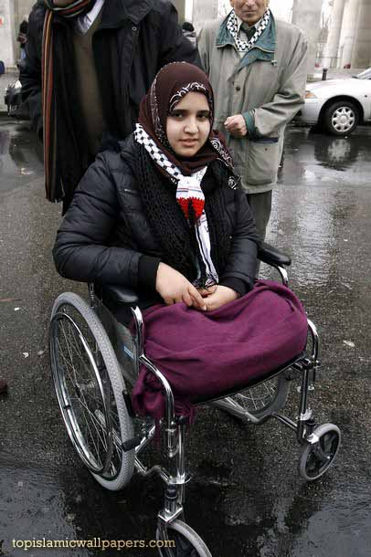 Jamila Al Habash poses on her wheelchair