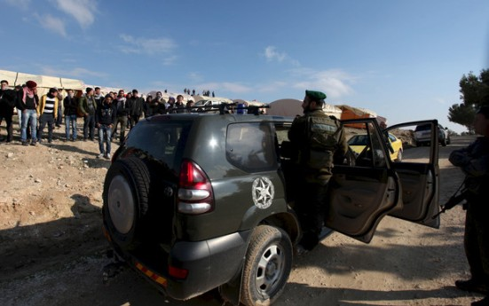 Israeli border policemen stood near what Palestinians called the new village of Bab Al Shams (Gate of the Sun), on Saturday 11 January 2013. Israeli forces raided and dismantled the encampment early Sunday.
