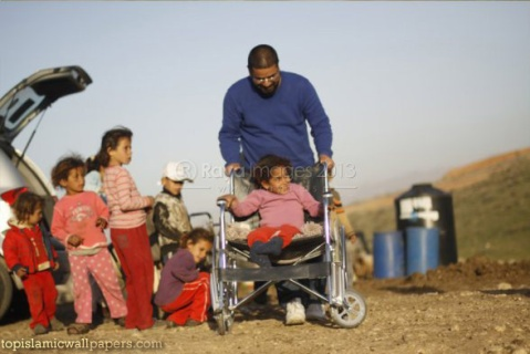 jan-15-2013-disabled-palestinian-child-in-jordan-valley-receives-new-wheelchair-2-photo-by-raya