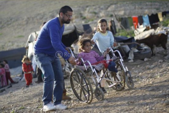 jan-15-2013-disabled-palestinian-child-in-jordan-valley-receives-new-wheelchair-photo-by-raya