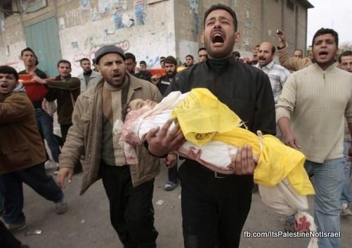 Palestinian cries as he carries body of Abu Etah during funeral in Beit Lahiya