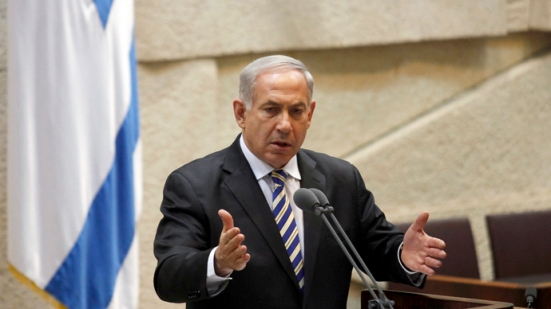 Israeli Prime Minister Benjamin Netanyahu gestures as he delivers a speech on June 5, 2013, at the Knesset, the Israeli parliament in Jerusalem. AFP PHOTO/GALI TIBBON