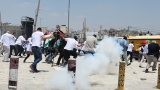 Israeli occupation forces suppressed Palestinian journalists in front of the Qalandiya checkpoint – July 17 2013