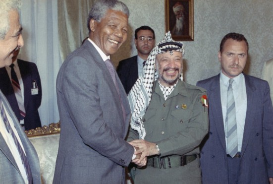 Nelson Mandela meets with Palestinian Liberation Organization Chairman Yasser Arafat, right, on Sunday, May 20, 1990 in Cairo. (Photo via news.naij.co)