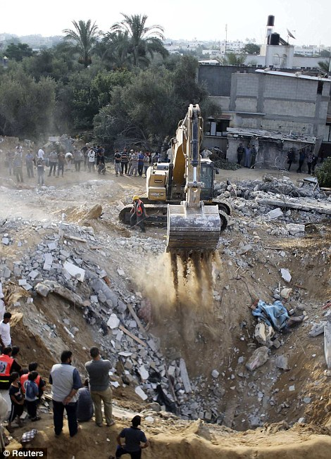 REFILE - CORRECTING TYPE OF MACHINERY</p><br /><br /><br /> <p> Palestinians gather as an excavator searches for victims amongst the rubble of a house, which police said was destroyed in an Israeli air strike, in Khan Younis in the southern Gaza Strip July 21, 2014. Israeli tanks shelled militant targets in the Gaza Strip on Monday and a woman died in an air strike after the bloodiest day of a nearly two-week military offensive that showed no signs of abating, despite global calls for a truce. Palestinian health officials said the death toll since July 8 had reached 447, including many civilians, with a woman killed in the predawn strike in Beit Hanoun and 12 more bodies recovered from the embattled Shejaia neighbourhood where the number of fatalities rose to 72 from Sunday's fighting. Israel's army said it had been targeting militants from Gaza's dominant Hamas group, charging that they fired rockets from Shejaia and built tunnels and command centres there. The army said it had warned civilians to leave two