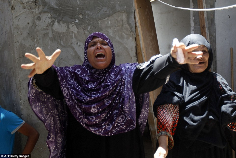 "Relatives mourn during the funeral of nine members of the Siam family, who were killed in an Israeli air strike that destroyed their house, on July 21, 2014 in Rafah in the southern Gaza Strip. Washington and the United Nations demanded an ""immediate ceasefire"" in Gaza as Israel pressed a blistering assault on the enclave, pushing the Palestinian death toll to 514.  AFP PHOTO / SAID KHATIBSAID KHATIB/AFP/Getty Images"