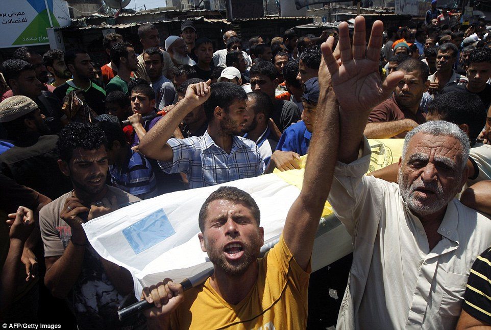 "Palestinian relatives and friends carry a body during the funeral of nine members of the Siam family, who were killed in an Israeli air strike that destroyed their house, on July 21, 2014 in Rafah in the southern Gaza Strip. Washington and the United Nations demanded an ""immediate ceasefire"" in Gaza as Israel pressed a blistering assault on the enclave, pushing the Palestinian death toll to 514.  AFP PHOTO / SAID KHATIBSAID KHATIB/AFP/Getty Images"