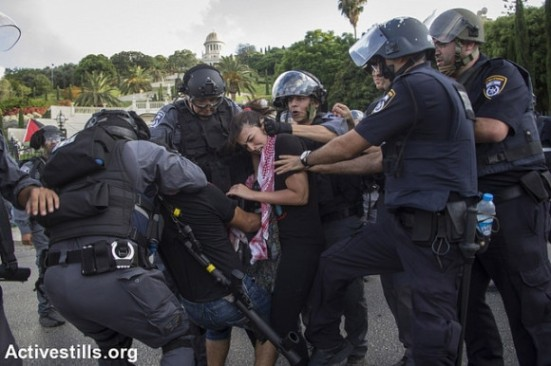 Israeli policemen arrest protesters as Palestnians living in Israel and left wing activists protest against the Israeli attack on Gaza in down town Haifa, July 18, 2014. (Photo: Activestills.org)