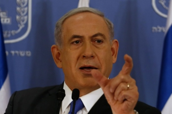 Israeli Prime Minister Benjamin Netanyahu speaks at the defense ministry in Tel Aviv on Friday (AFP)