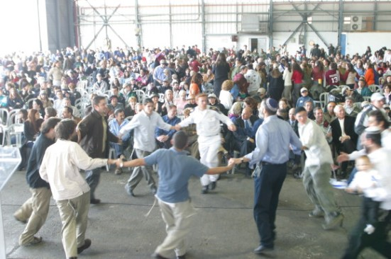 "A recent welcoming ceremony for Jews making ""aliyah"" to Israel, at the Nefesh b'Nefesh site"
