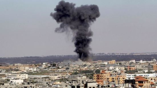 Smoke rises after an Israeli air strike in Rafah, in the southern Gaza Strip