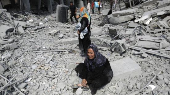 A Palestinian woman reacts as she witnesses the destruction of houses in the northern district of Beit Hanoun in the Gaza Strip. (File photo)