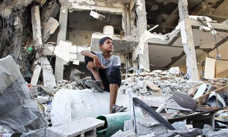 A Palestinian boy amid ruined houses in Beit Lahiya as the 72-hour ceasefire went into its third day