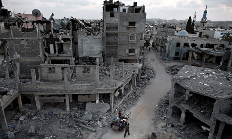 Palestinians flee their destroyed neighbourhood in Beit Hanoun, Gaza, on Monday. Photograph: Thomas Coex/AFP/Getty Images