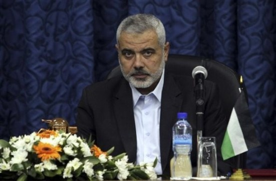 Gaza's Hamas Prime Minister Ismail Haniyeh attends a meeting with his ministers in his office in Gaza City, Sunday, Oct. 16, 2011. The relatives of Israelis killed in Palestinian attacks waged a charged debate Sunday over the planned release of militants this week in a deal to free an Israeli soldier held by Hamas for five years. (AP Photo/Hatem Moussa)