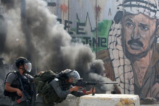 Israeli soldiers keep their position dur