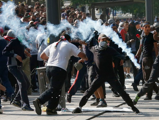 Protesters throw projectiles in Place de la Republique during a banned demonstration in support of Gaza in central Paris, July 26, 2014. (Reuters/Benoit Tessier)