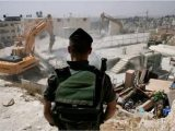 Israeli bulldozers demolish Palestinian structures in WestBank