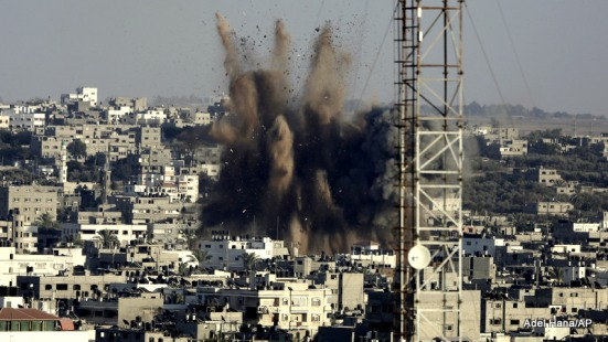 Smoke, dust and derbies rise after an Israeli strike in Gaza City in the northern Gaza Strip on Sunday, Aug. 10, 2014.